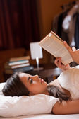 Reading before sleep. — Stock Photo