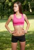 Young brunette fitness girl. — Stock Photo