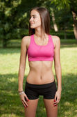 Beautiful slender young fitness girl. — Stock Photo