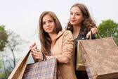 Fashionable shopping beauties. — Stock Photo
