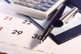 Pen, Calculator, Calendar and Cheque Book — Stock Photo