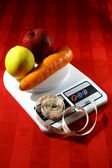 Fruits and Vegetable on a Weighing Scale with a Measuring Tape — Stock Photo