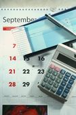 Calendar, checkbook, calculator, money and a ballpen — Stock Photo