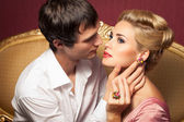 Young man wants kiss beautiful young woman — Stock Photo