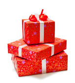 Three gifts in red packing isolated on white background — Stock Photo