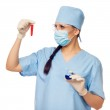 Woman doctor with red flask in their hands — Stock Photo