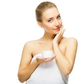 Beautiful blond woman tender jar of moisturizer cream — Stock Photo