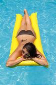 Woman floating on mattress — Stock Photo