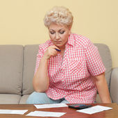 Woman calculating her debts — Stock Photo