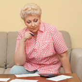 Woman thinks about her debts — Stock Photo