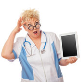 Doctor senior woman holding tablet computer — Stock Photo