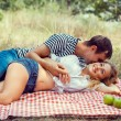 Young couple on picnic. lying embrace. — Stock Photo