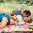 Young couple on picnic. lying embrace. — Stock Photo #29375057