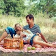 Young couple have a rest on picnic — Stock Photo