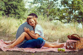 Couple on picnic, sitting closed eyes — Stock Photo