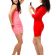 Two young women standing and picture taken — Stock Photo #42466437