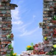 Stock Photo: Arched entrance through Wall and sky background