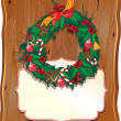 Christmas garland on wooden background — Imagens vectoriais em stock