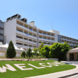 Stock Photo: Hotel entrance with green lawn and word WELCOME
