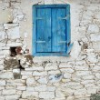 Old Wooden window with shutters painted blue color — 图库照片