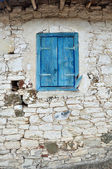 Old Wooden window with shutters painted blue color — Stock Photo