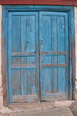 Old Wooden Door painted blue color — Stock Photo