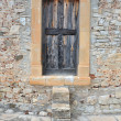 Stock Photo: Old Wooden Door on brick wall