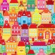 图库矢量图片: Seamless pattern with decorative colorful houses. City endless