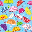 Seamless pattern with colorful umbrellas on blue background — Векторная иллюстрация