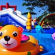 Inflatable toys in children sweeming pool and inflatable castle — Stock Photo