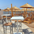 Outdoor restaurant at the beach. Vertical picture. Sea view, Bud — Stockfoto