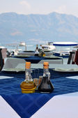 Bottle of olive oil and italian balsamic vinegar on blue tablecl — Stok fotoğraf