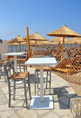 Outdoor restaurant at the beach. Vertical picture. Sea view, Bud — Stock Photo