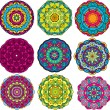 Stock Vector: Set of 9 colorful round ornaments, kaleidoscope floral patterns.