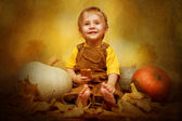 Child and pumpkins — Stock Photo