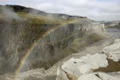 Rainbow over Dettifoss gorge, Iceland. — Stock Photo