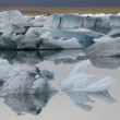 Melting ice on calm water. — Stock Photo