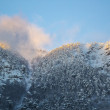 Snow mountains at sunset with fog — Stock Photo #27929837