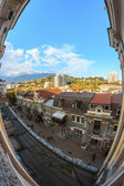 City sunset at window fisheye — Stock Photo