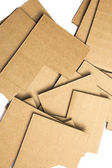 Many pieces of cardboard on white background — Stock Photo