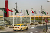 Flags on square near Dubai mall — Stock Photo