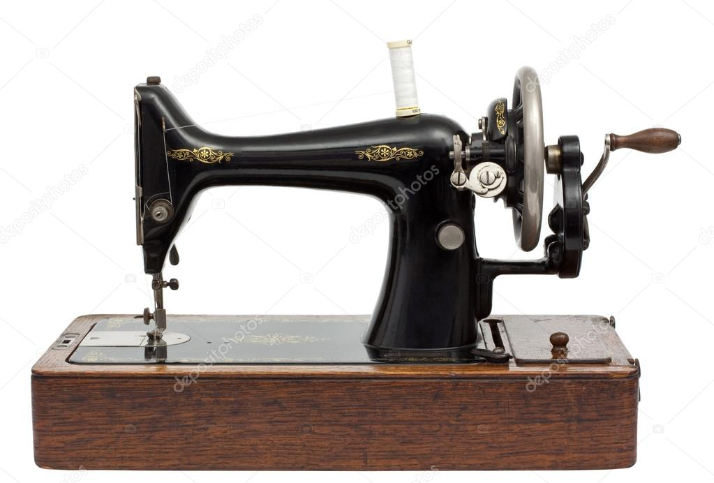 Antique Sewing Machine isolated on white with clipping path — Stock Photo #12620045