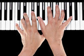 Hands on a Piano Keyboard — Stock Photo