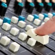 Finger on Mixing Desk - Stock Photo