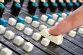 Finger on Mixing Desk — Stock Photo