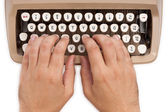 Hands on a typewriter — Stock Photo
