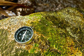 Compass on the rock — Stock Photo