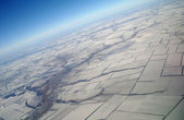 View of Earth from a height covered with snow during the winter season — Stock Photo