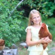 Young Blonde Girl in the Garden with Her Chickens — Foto Stock