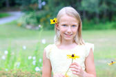 Blond Girl Holding a Flower — Stock Photo